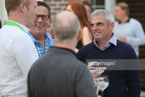 Paul McGinley talks to other guest during the Arabian Nights party after Day Two of the Dubai Duty Free Irish Open at Portstewart Golf Club on July 7...