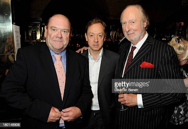 Paul McGuinness Geordie Greig and Ed Victor attend the Tatler Bystander exhibition featuring the 50 best party pictures of the past 50 years at...