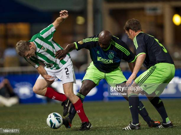 Paul McGunnigle of KCC Veterans and Aron Winter of Ajax All Stars fight for the ball on Day one of the Hong Kong International Soccer Sevens at Hong...