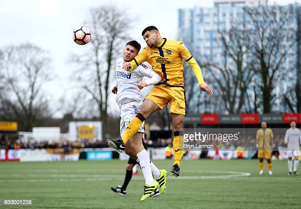 Paul McKay of Leeds United and Maxime Biamou of Sutton United battle to win a header during The Emirates FA Cup Fourth Round match between Sutton...