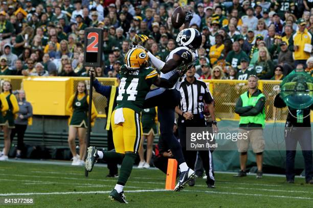 Paul McRoberts of the Los Angeles Rams fails to make a catch while being guarded by Donatello Brown of the Green Bay Packers in the second quarter...