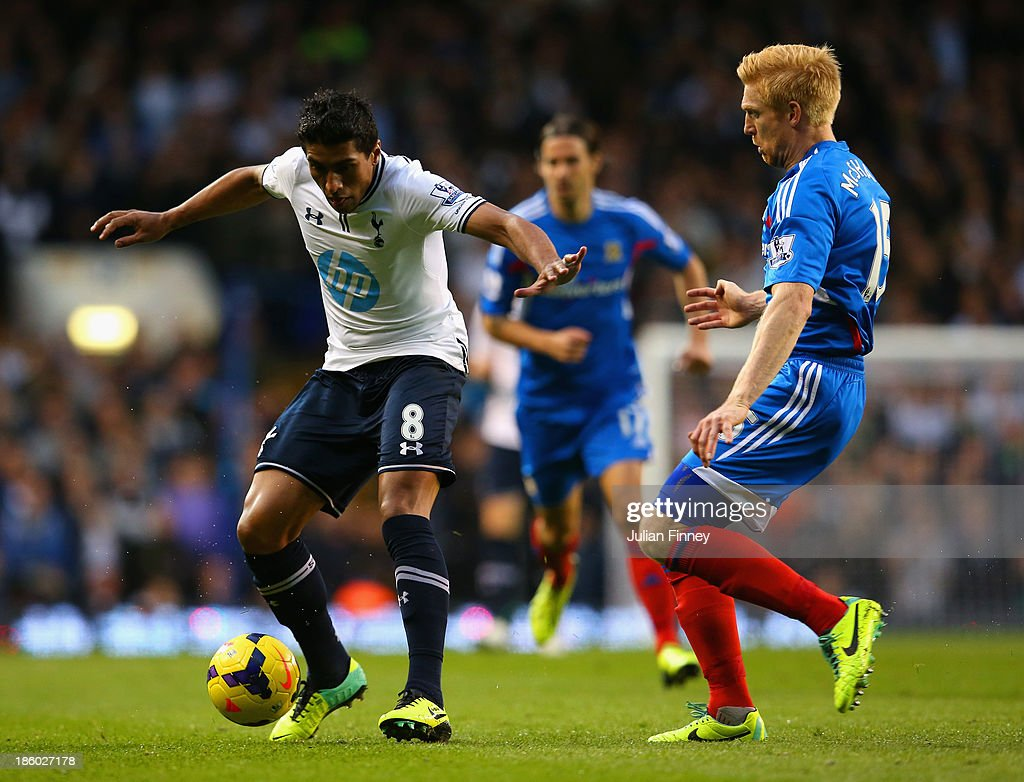 Paul McShane of Hull City closes down Paulinho of Spurs during the Barclays Premier League match between Tottenham Hotspur and Hull City at White Hart Lane on October 27, 2013 in London, England.