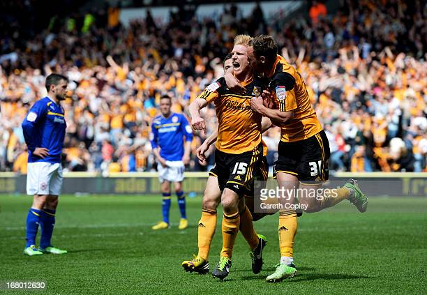 Paul McShane of Hull is congratulated by teammate David Meyler after scoring his team's second goal during the npower Championship match between Hull...