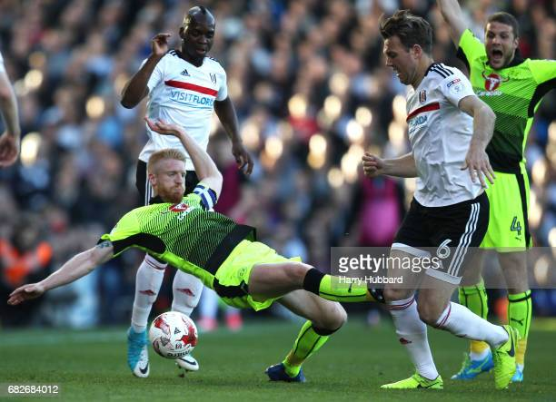 Paul McShane of Reading fouls Kevin McDonald of Fulham and is later sent off for the challenge during the Sky Bet Championship Play off semi final...