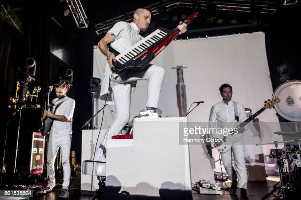 Paul Meany Todd Gummerman and Jonathan Allen of the band Mutemath perform at The Observatory on October 14 2017 in Santa Ana California