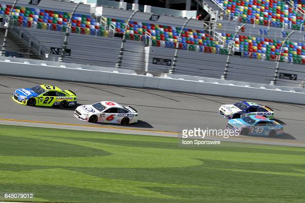 Paul Menard and Trevor Bayne lead Aric Almirola and Ty Dillon through the front stretch during practice for the NASCAR Monster Energy Cup Series...