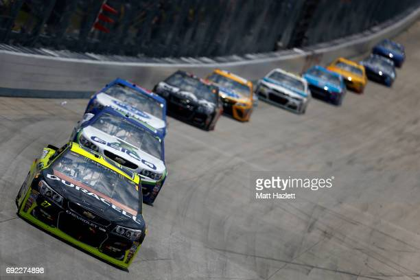 Paul Menard driver of the Duracell/Menards Chevrolet leads a pack of cars during the Monster Energy NASCAR Cup Series AAA 400 Drive for Autism at...