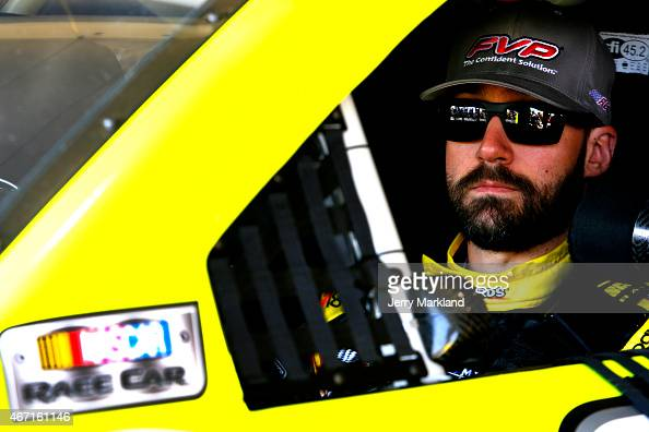 Paul Menard driver of the FVP/ Menard's Chevrolet sits in his car during practice for the NASCAR Sprint Cup Series Auto Club 400 at Auto Club...