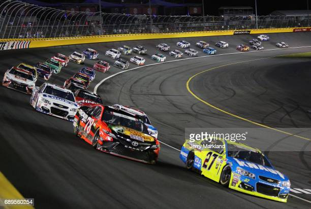 Paul Menard driver of the Knauf/Menards Chevrolet leads a pack of cars during the Monster Energy NASCAR Cup Series CocaCola 600 at Charlotte Motor...