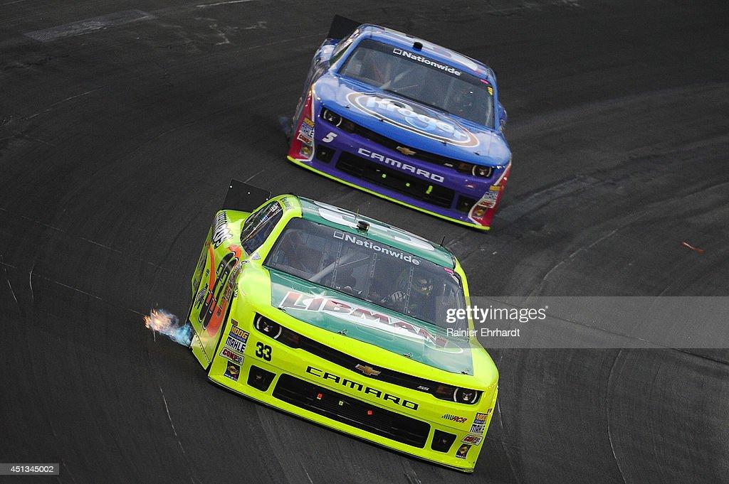 Paul Menard driver of the Libman/Menards Chevrolet races Kevin Harvick driver of the Kroger/PG Chevrolet during the NASCAR Nationwide Series John R...