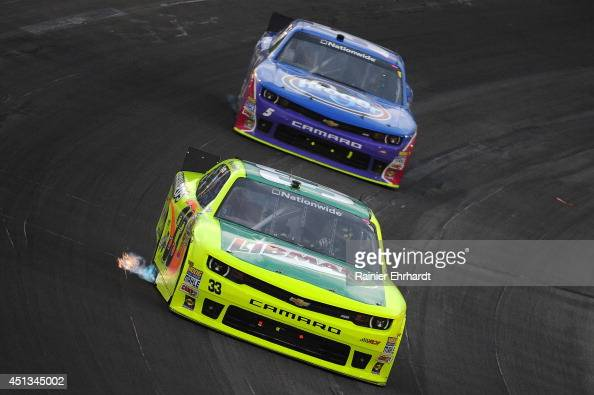Paul Menard driver of the Libman/Menards Chevrolet races Kevin Harvick driver of the Kroger/PG Chevrolet during the NASCAR Nationwide Series John R...