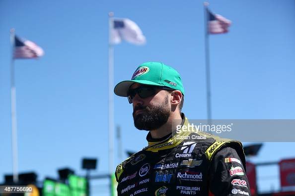 Paul Menard driver of the Libman/Menards Chevrolet walks through the garage area during practice for the NASCAR Sprint Cup Series Federated Auto...