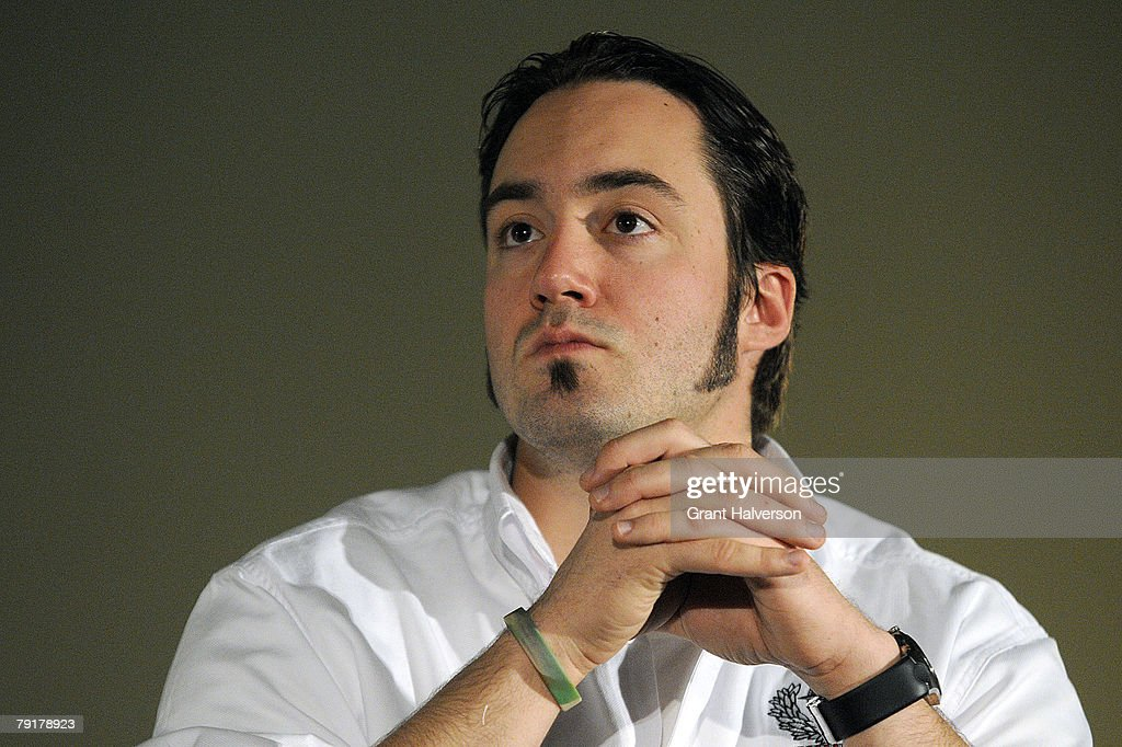 Paul Menard, driver of the #15 Menards Chevrolet, listens during a media event at Dale Earnhardt, Inc. on January 23, 2007 in Mooresville, North Carolina.