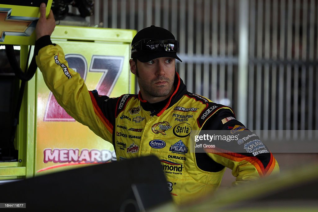 Paul Menard, driver of the #27 Menards/CertainTeed Chevrolet, stands in the garage area during practice for the NASCAR Sprint Cup Series Auto Club 400 at Auto Club Speedway on March 23, 2013 in Fontana, California.