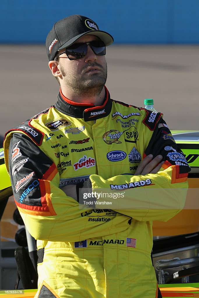 Paul Menard, driver of the #27 Menard's/Serta Chevrolet, stands by his car during qualifying for the NASCAR Sprint Cup Series Subway Fresh Fit 500 at Phoenix International Raceway on March 1, 2013 in Avondale, Arizona.