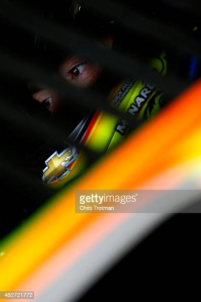 Paul Menard driver of the Moen / Menard's Chevrolet sits in his car during practice for the NASCAR Sprint Cup Series Crown Royal Presents The John...