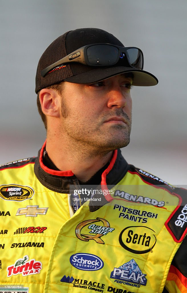 Paul Menard driver of the MOEN/Menard's Chevrolet looks on during qualifying for the NASCAR Sprint Cup Series AdvoCare 500 at Atlanta Motor Speedway...