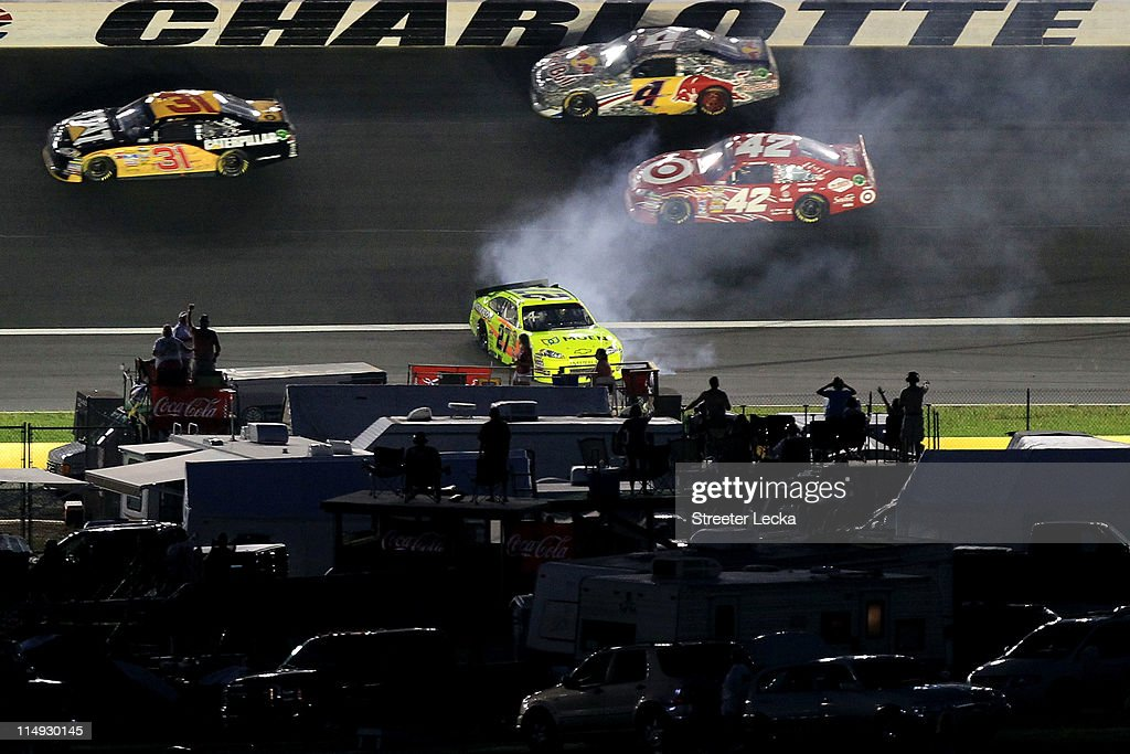 <a gi-track='captionPersonalityLinkClicked' href=/galleries/search?phrase=Paul+Menard&family=editorial&specificpeople=540271 ng-click='$event.stopPropagation()'>Paul Menard</a>, driver of the #27 Moen/Menards Chevrolet, spins out as <a gi-track='captionPersonalityLinkClicked' href=/galleries/search?phrase=Jeff+Burton&family=editorial&specificpeople=216559 ng-click='$event.stopPropagation()'>Jeff Burton</a>, driver of the #31 Caterpillar Chevrolet, <a gi-track='captionPersonalityLinkClicked' href=/galleries/search?phrase=Kasey+Kahne&family=editorial&specificpeople=183374 ng-click='$event.stopPropagation()'>Kasey Kahne</a>, driver of the #4 Red Bull Toyota, and <a gi-track='captionPersonalityLinkClicked' href=/galleries/search?phrase=Juan+Pablo+Montoya&family=editorial&specificpeople=202004 ng-click='$event.stopPropagation()'>Juan Pablo Montoya</a>, driver of the #42 Target Chevrolet, drive past him after an incident in the NASCAR Sprint Cup Series Coca-Cola 600 at Charlotte Motor Speedway on May 29, 2011 in Concord, North Carolina.