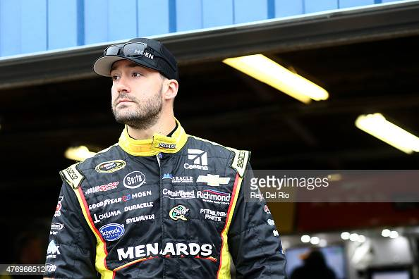 Paul Menard driver of the Moen/Menards Chevrolet stands in the garage area during practice for the NASCAR Sprint Cup Series Quicken Loans 400 at...
