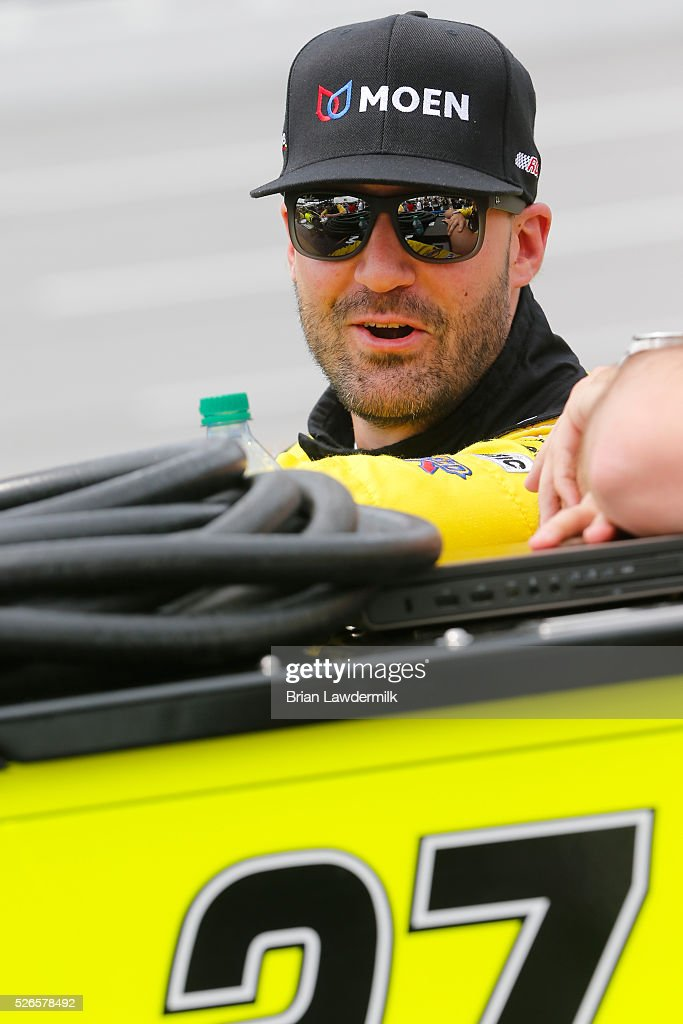 Paul Menard, driver of the #27 Moen/Menards Chevrolet, stands on the grid during qualifying for the NASCAR Sprint Cup Series GEICO 500 at Talladega Superspeedway on April 30, 2016 in Talladega, Alabama.