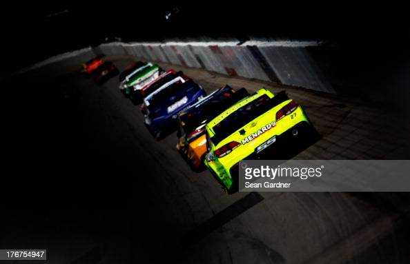 Paul Menard driver of the Nibco / Menard's Chevrolet races the NASCAR Sprint Cup Series 44th Annual Pure Michigan 400 at Michigan International...