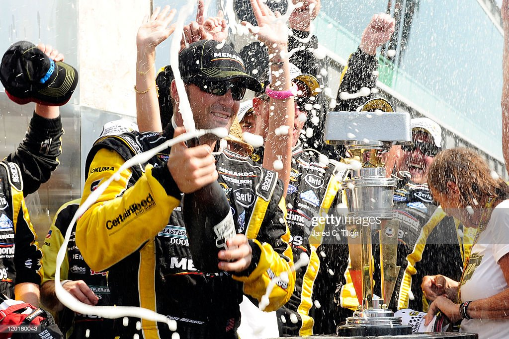 Paul Menard driver of the NIBCO/Menards Chevrolet celebrates in Victory Lane after winning the NASCAR Sprint Cup Series Brickyard 400 at Indianapolis...