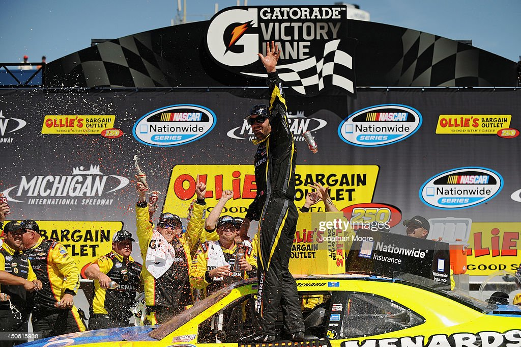 Paul Menard, driver of the #33 Nibco/Menards Chevrolet, celebrates in Victory Lane after winning during the NASCAR Nationwide Series Ollie's Bargain Outlet 250 at Michigan International Speedway on June 14, 2014 in Brooklyn, Michigan.