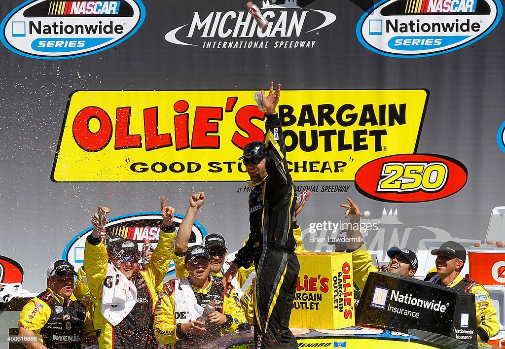 <a gi-track='captionPersonalityLinkClicked' href=/galleries/search?phrase=Paul+Menard&family=editorial&specificpeople=540271 ng-click='$event.stopPropagation()'>Paul Menard</a>, driver of the #33 Nibco/Menards Chevrolet, celebrates in Victory Lane after winning the NASCAR Nationwide Series Ollie's Bargain Outlet 250 at Michigan International Speedway on June 14, 2014 in Brooklyn, Michigan.