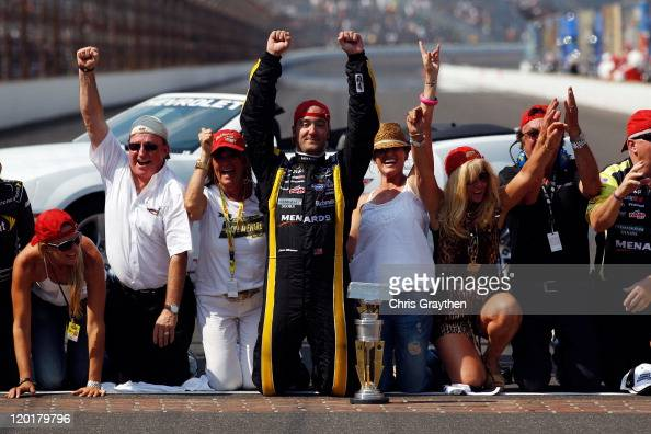 Paul Menard driver of the NIBCO/Menards Chevrolet celebrates on the bricks after winning the NASCAR Sprint Cup Series Brickyard 400 at Indianapolis...