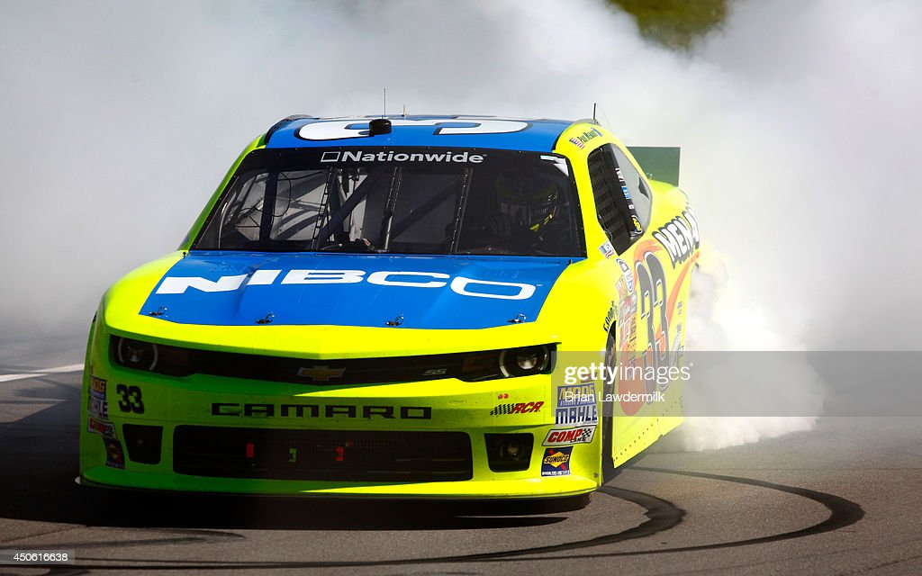 <a gi-track='captionPersonalityLinkClicked' href=/galleries/search?phrase=Paul+Menard&family=editorial&specificpeople=540271 ng-click='$event.stopPropagation()'>Paul Menard</a>, driver of the #33 Nibco/Menards Chevrolet, celebrates with a burnout after winning the NASCAR Nationwide Series Ollie's Bargain Outlet 250 at Michigan International Speedway on June 14, 2014 in Brooklyn, Michigan.