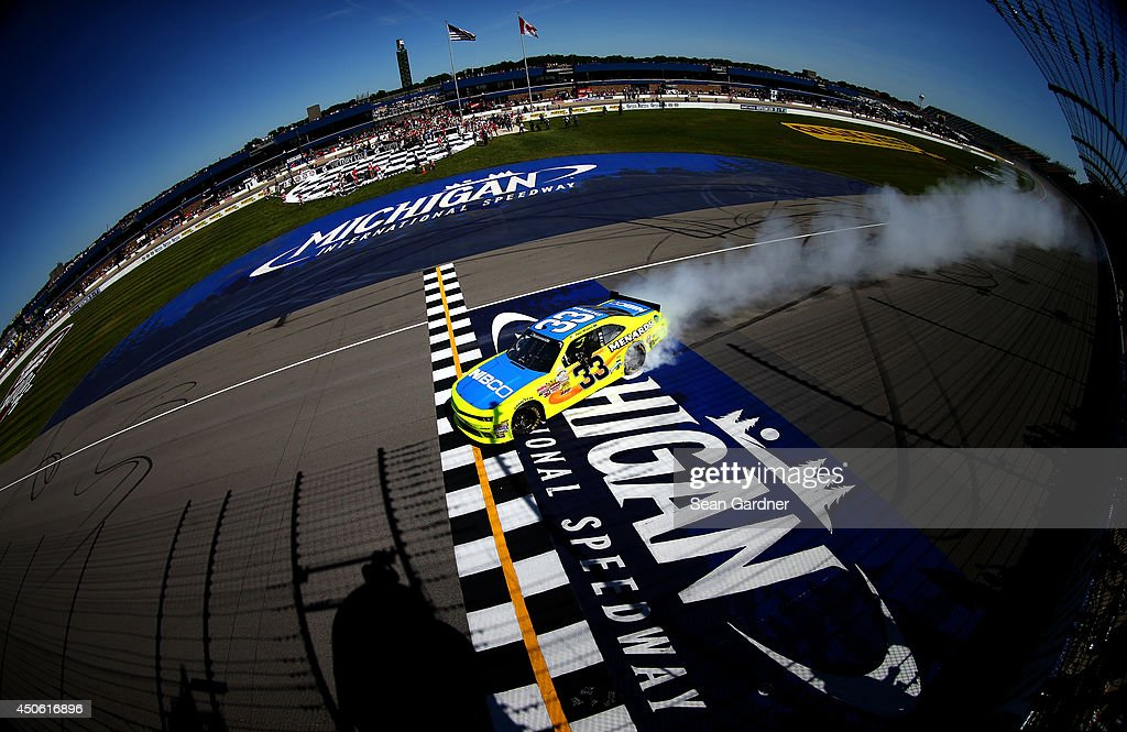 Paul Menard, driver of the #33 Nibco/Menards Chevrolet, celebrates with a burnout after winning the NASCAR Nationwide Series Ollie's Bargain Outlet 250 at Michigan International Speedway on June 14, 2014 in Brooklyn, Michigan.