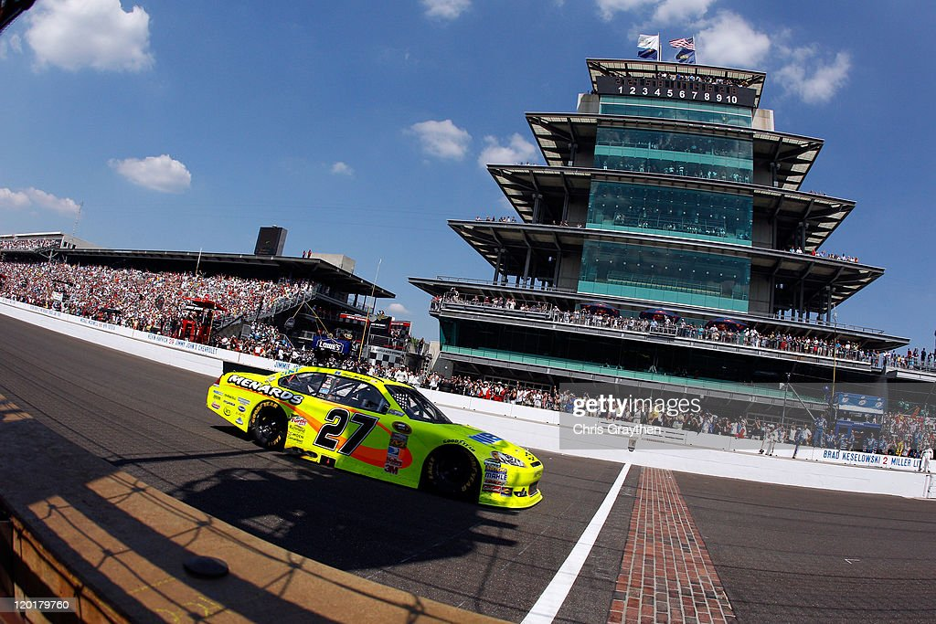 Paul Menard driver of the NIBCO/Menards Chevrolet crosses the finish line to win the NASCAR Sprint Cup Series Brickyard 400 at Indianapolis Motor...