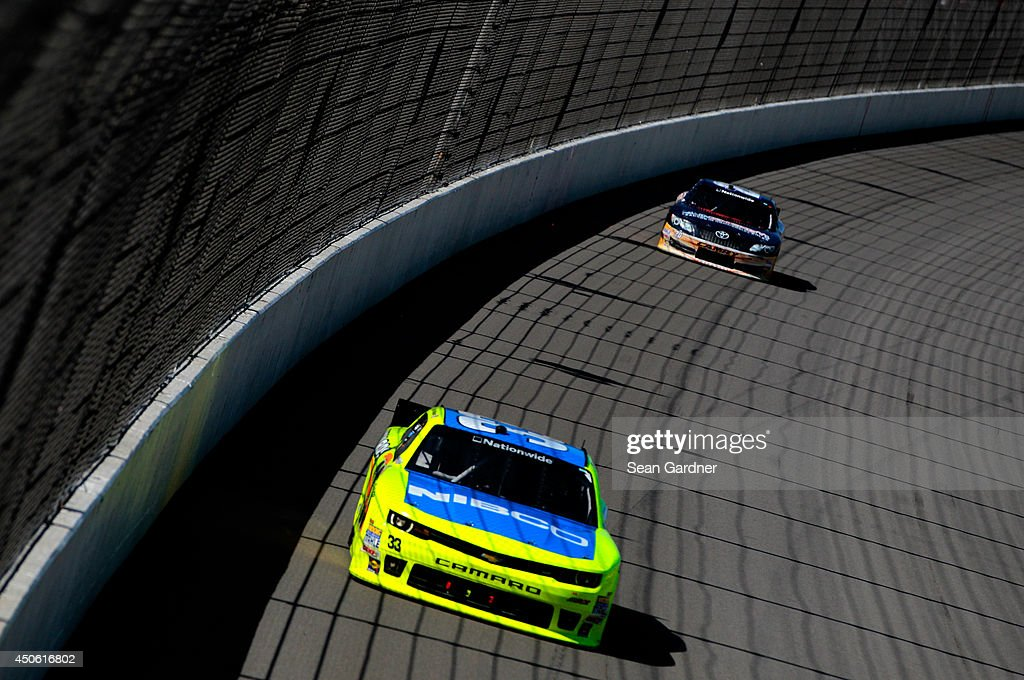 <a gi-track='captionPersonalityLinkClicked' href=/galleries/search?phrase=Paul+Menard&family=editorial&specificpeople=540271 ng-click='$event.stopPropagation()'>Paul Menard</a>, driver of the #33 Nibco/Menards Chevrolet, leads <a gi-track='captionPersonalityLinkClicked' href=/galleries/search?phrase=Sam+Hornish+Jr.&family=editorial&specificpeople=176571 ng-click='$event.stopPropagation()'>Sam Hornish Jr.</a>, driver of the #20 Sun Energy 1 Toyota, in the final laps of the NASCAR Nationwide Series Ollie's Bargain Outlet 250 at Michigan International Speedway on June 14, 2014 in Brooklyn, Michigan.