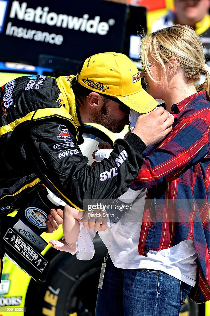 Paul Menard, driver of the #33 Nibco/Menards Chevrolet, left, celebrates in victory lane with wife Jennifer and daughter Remi after winning the NASCAR Nationwide Series Ollie's Bargain Outlet 250 at Michigan International Speedway on June 14, 2014 in Brooklyn, Michigan.
