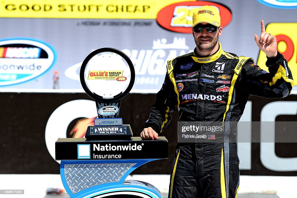 <a gi-track='captionPersonalityLinkClicked' href=/galleries/search?phrase=Paul+Menard&family=editorial&specificpeople=540271 ng-click='$event.stopPropagation()'>Paul Menard</a>, driver of the #33 Nibco/Menards Chevrolet, poses with the trophy in Victory Lane after winning the NASCAR Nationwide Series Ollie's Bargain Outlet 250 at Michigan International Speedway on June 14, 2014 in Brooklyn, Michigan.