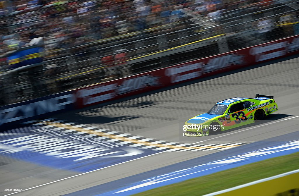 <a gi-track='captionPersonalityLinkClicked' href=/galleries/search?phrase=Paul+Menard&family=editorial&specificpeople=540271 ng-click='$event.stopPropagation()'>Paul Menard</a>, driver of the #33 Nibco/Menards Chevrolet, takes the checkered flag to win the NASCAR Nationwide Series Ollie's Bargain Outlet 250 at Michigan International Speedway on June 14, 2014 in Brooklyn, Michigan.