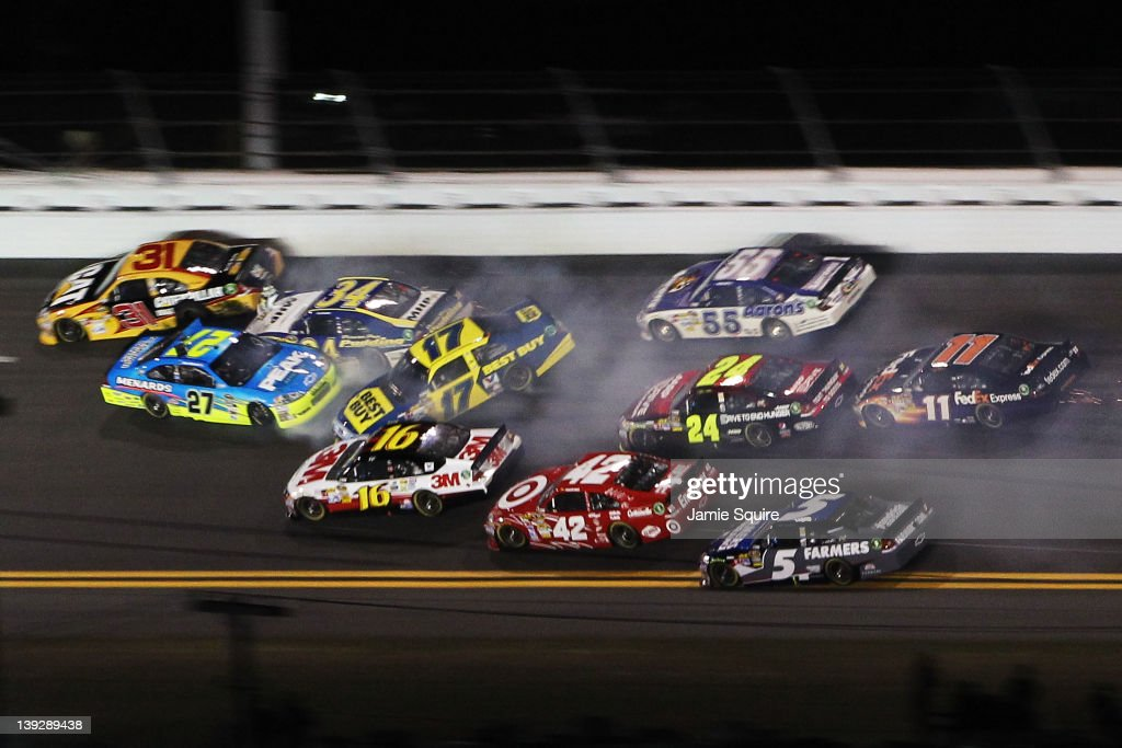 Paul Menard driver of the Peak/Menards Chevrolet David Ragan driver of the Front Row Motorsports Ford Michael Waltrip driver of the Aaron's Toyota...