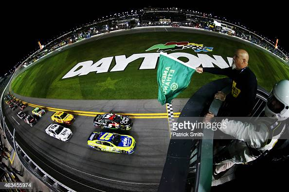 Paul Menard driver of the Peak/Menard's Chevrolet leads the field to the green flag to start the 3rd Annual Sprint Unlimited at Daytona at Daytona...
