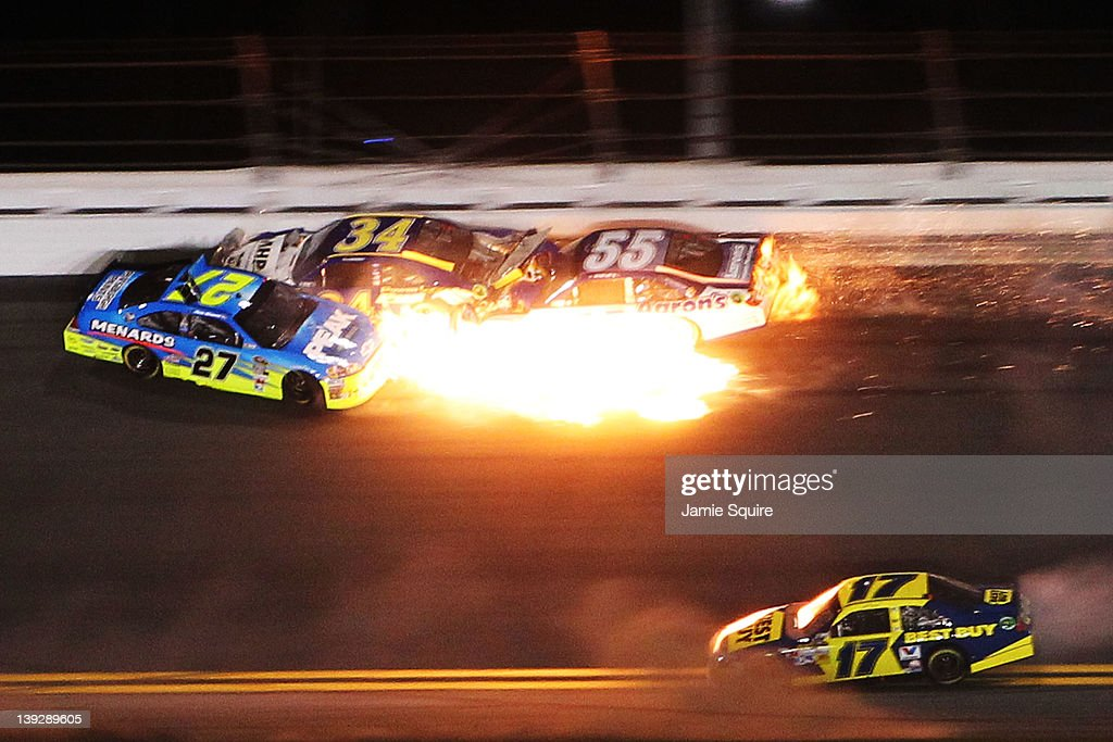 Paul Menard driver of the Peak/Menards Chevrolet spins while David Ragan driver of the Front Row Motorsports Ford and Michael Waltrip driver of the...