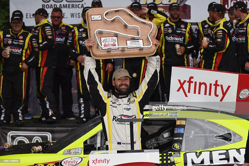 Paul Menard driver of the Richmond/Menards Chevrolet celebrates after taking first in the Xfinity Series Road America 180 Fired Up by Johnsonville on...