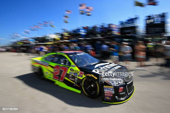 Paul Menard driver of the Richmond/Menards Chevrolet drives through the garage area during practice for the NASCAR Sprint Cup Series Ford EcoBoost...