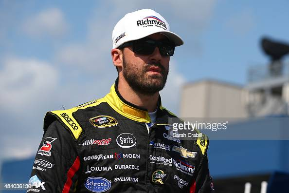 Paul Menard driver of the Richmond/Menards Chevrolet stands on the grid during qualifying for the NASCAR Sprint Cup Series Pure Michigan 400 at...