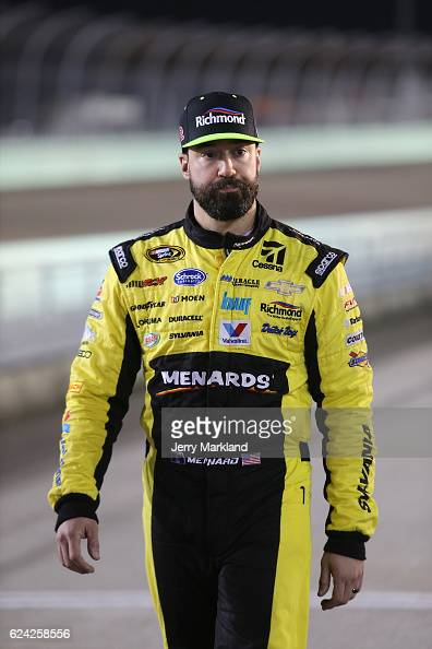 Paul Menard driver of the Richmond/Menards Chevrolet walks on the grid during qualifying for the NASCAR Sprint Cup Series Ford EcoBoost 400 at...