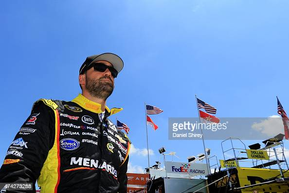 Paul Menard driver of the Serta/Menards Chevrolet walks in the garage area during practice for the NASCAR Sprint Cup Series CocaCola 600 at Charlotte...