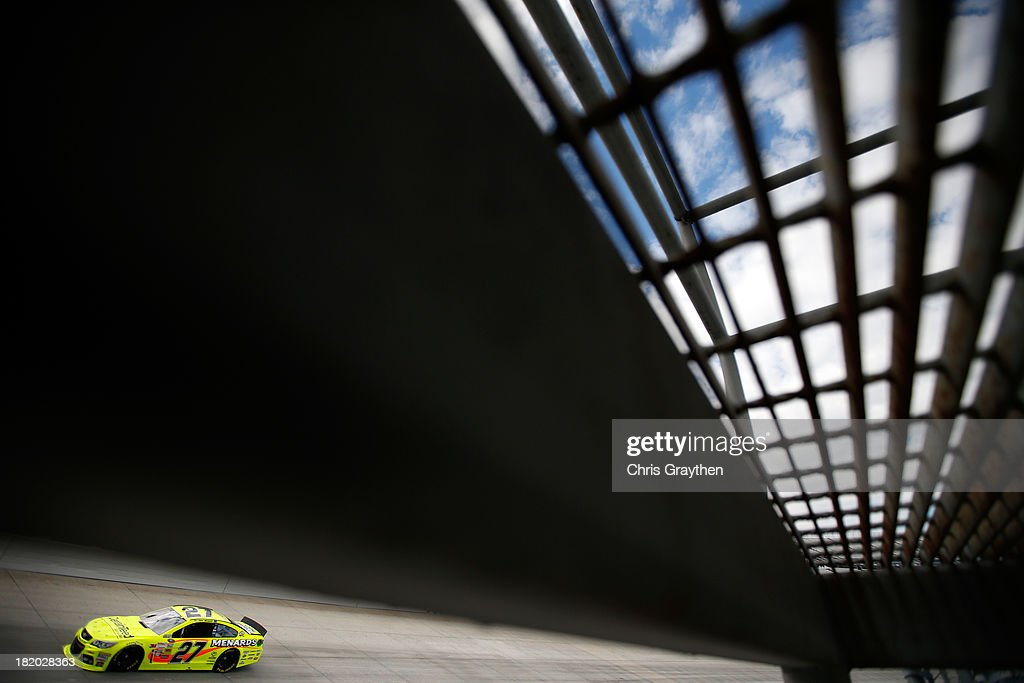 Paul Menard drives the #27 Menard's / CertainTeed Chevrolet during qualifying for the NASCAR Sprint Cup Series AAA 400 at Dover International Speedway on September 27, 2013 in Dover, Delaware.