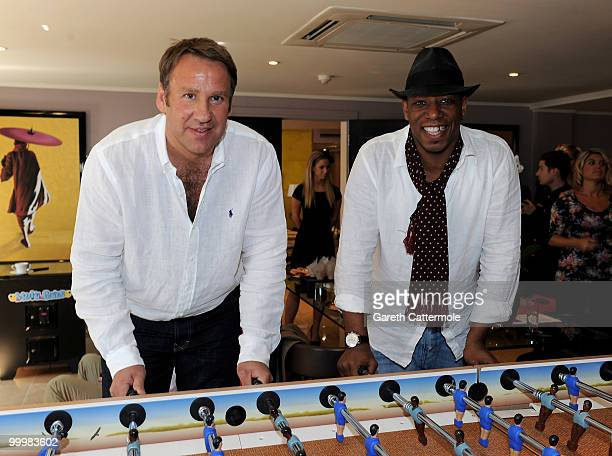 Paul Merson and Ian Wright attend a photocall to launch Lastminutecom's World Cup offers at The Mayfair Hotel on May 19 2010 in London England