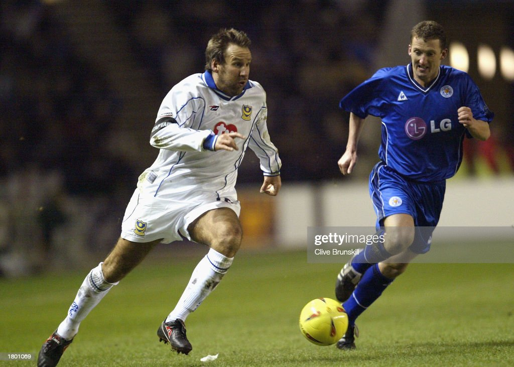 Paul Merson of Portsmouth gets past Billy McKinlay of Leicester during the Nationwide League Division One match between Leicester City and Portsmouth at Walkers Stadium, Leicester, England on February 17, 2003.