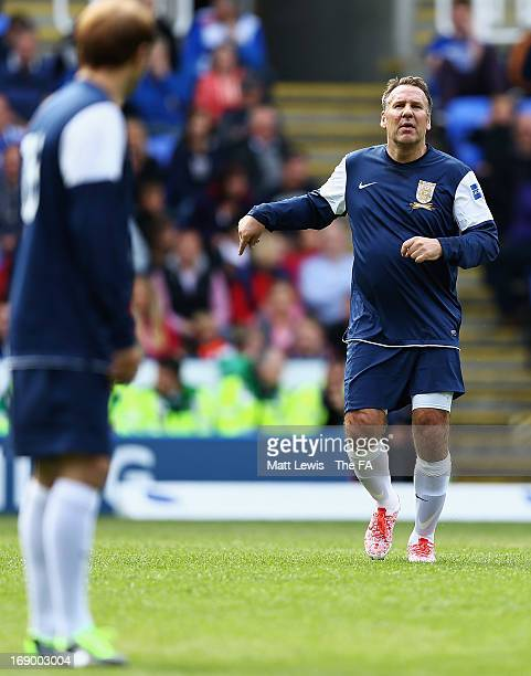 Paul Merson of the FA Legends in action during the Army FA and FA Legends Match at Madejski Stadium on May 18 2013 in Reading England