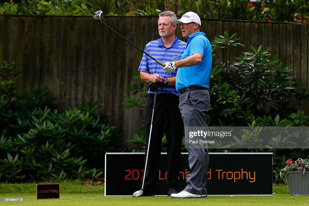 Paul Middleton (R) and Mike Boutcher of South Herefordshire Golf Club talk during The Lombard Trophy Midland Regional Qualifier at Little Aston Golf Club on July 4, 2014 in Sutton Coldfield, England.