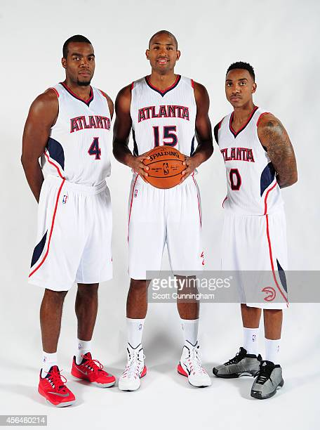 Paul Millsap Al Horford and Jeff Teague of the Atlanta Hawks pose for a photograph during the Atlanta Hawks Media Day on September 29 2014 at Philips...